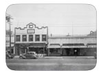 East of North Street between B and A street., circa 1946. View of garage, G.E. Schulze building, built in 1892 following a fire to John Casey's Blacksmith shop. After Schulze's death in 1963, it was used for offices and a hotel. The Dixon Theatre was built in 1926 by Gerlach