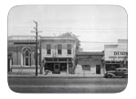 Downtown Dixon in 1946 - View of Bank of America - Quick Lunch Café , Doctor's office, Weiglels Garage, B and first street, east side.